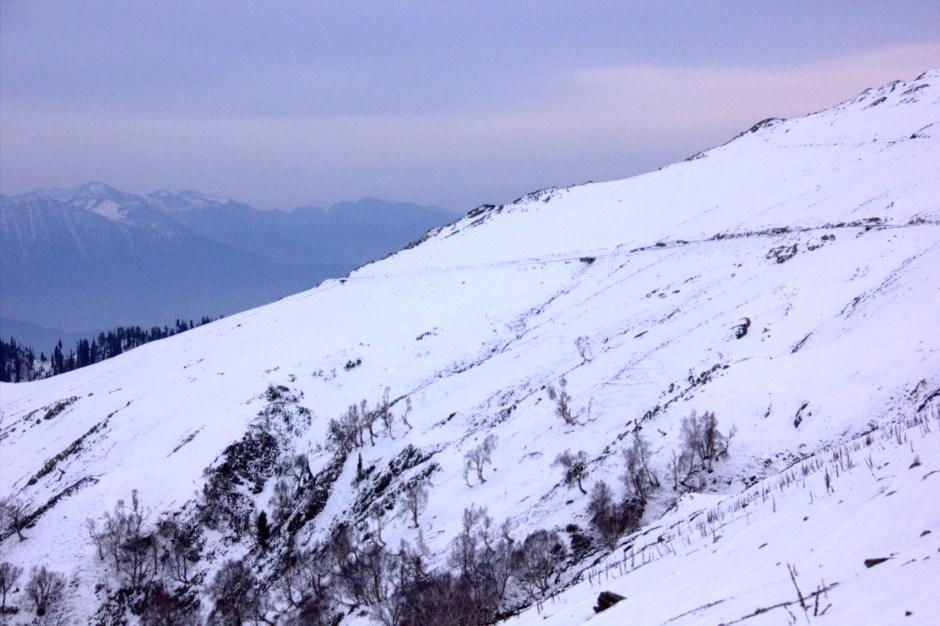 Snow covered mountains circle Gurez