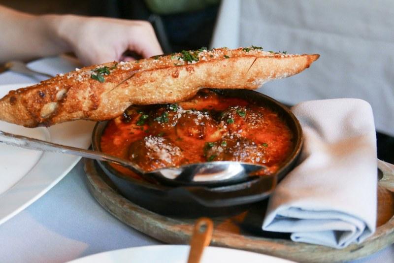 Prime Rib Meatballs, Caramelized Tomato Sauce, Cheese Curds, Garlic Bread ($16)