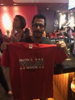 Danny Wood On Election Day Holding a t-shirt