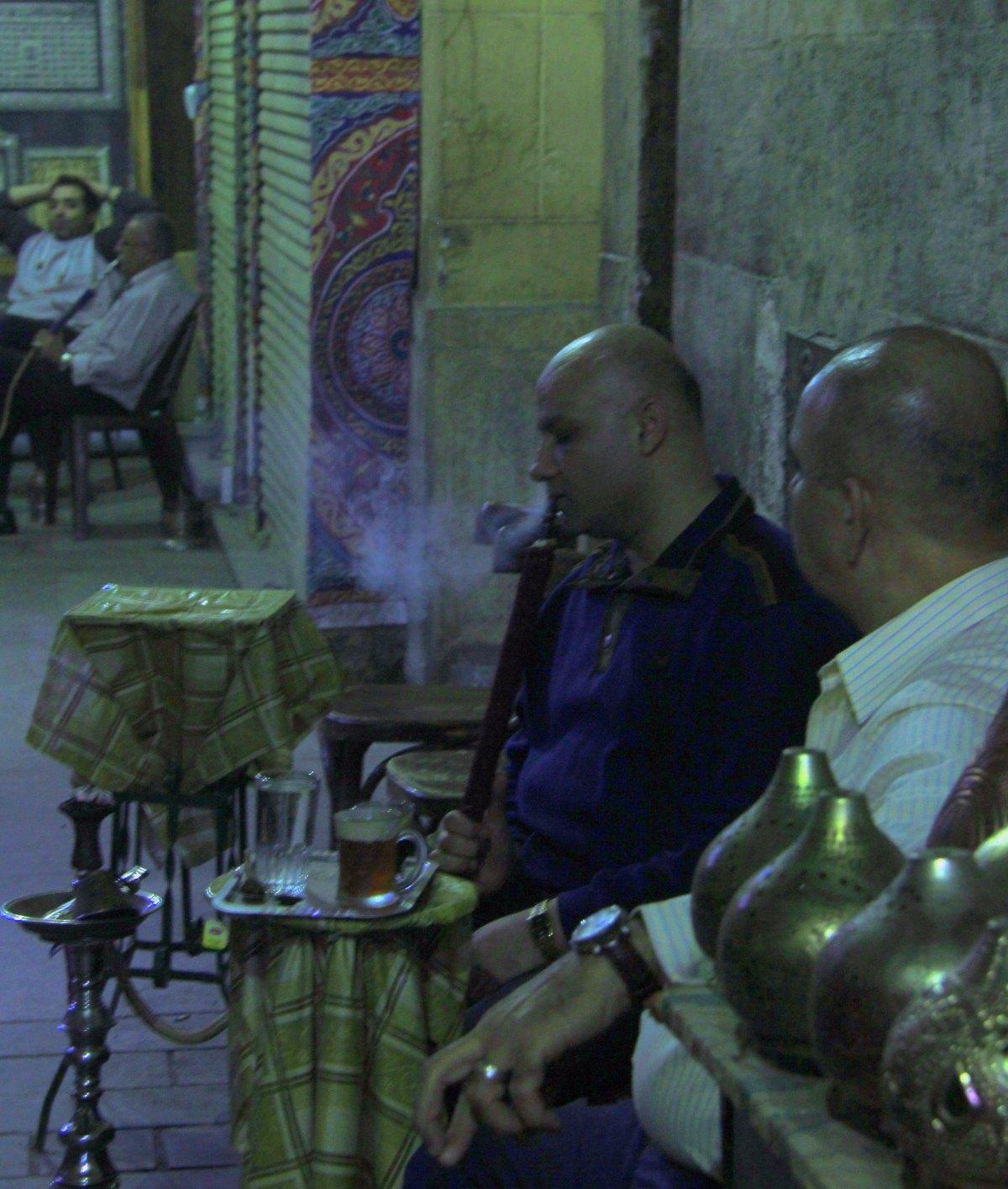 men smoking shisha at khan el khalili market