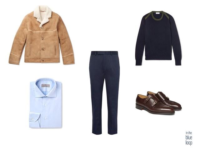 Cazadora de piel de oveja en look masculino smart-casual con pantalón de vestir, zapatos monk, camisa azul y jersey azul