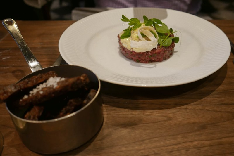 Stirred tartare of beef, poached egg, mustard cream ($23)