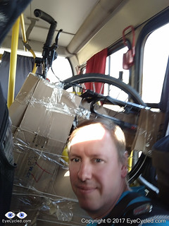 Me, in the bus from Ribeirão to Sertãozinho, seating in the seat usally reserved for disabled passengers and holding the bike upright.