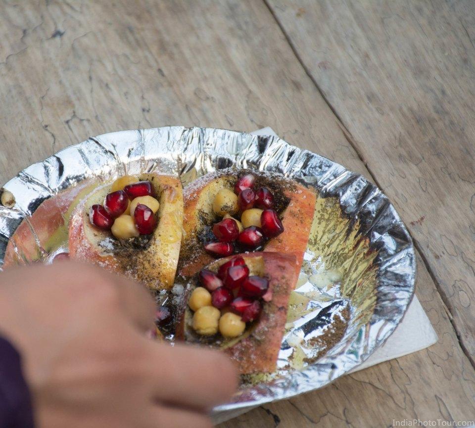 Kulia chat made with apples, chick peas, powdered sugar, pomegranate, chaat masala and lemon juice