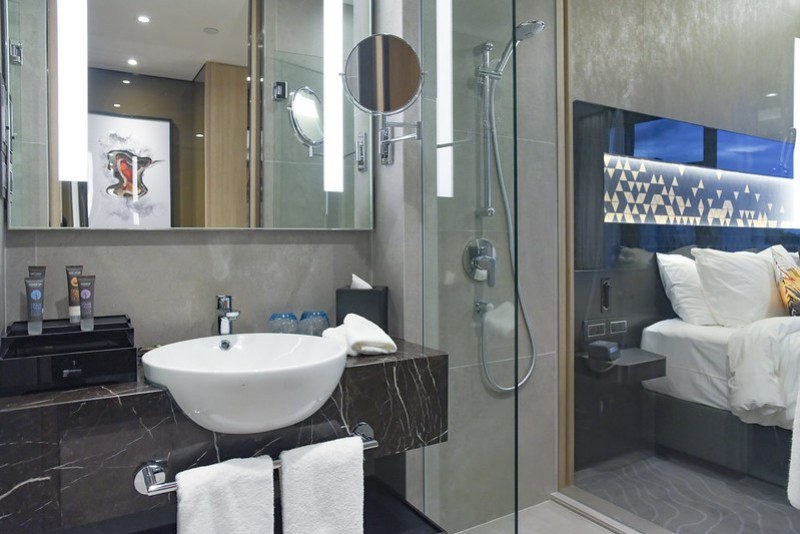 wash area at the deluxe room - novotel singapore on stevens