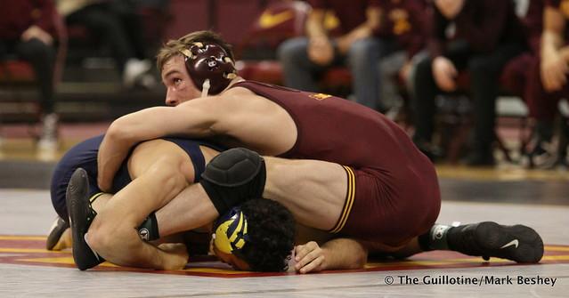 149: Malik Amine (Michigan) dec. No. 16 Steve Bleise (Minnesota) 6-4. 180121AMK0023
