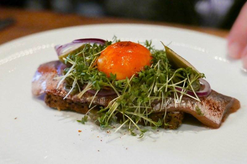 Pickled herring, chili, egg yolk smørrebrød ($16)