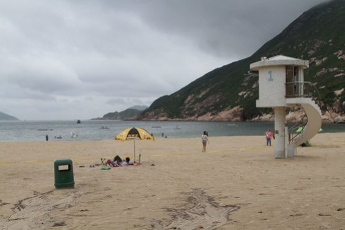 Concrete lifeguard towers on the beach at Shek O