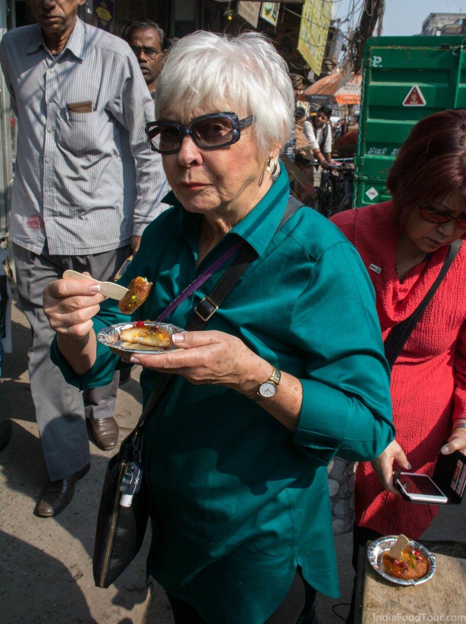 Getting a taste of freshly fried Aaloo tikkii served with mint and tamarind chutneys in old Delhi's food walk
