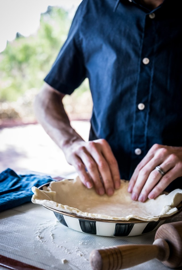 press the dough into the pie plate, eliminating any air bubbles