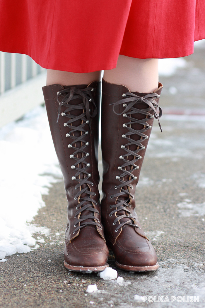 Tall lace up boots worn with dragon sweater