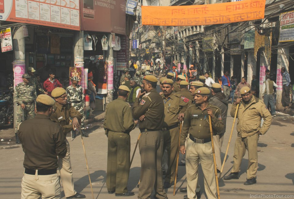 Local policemen on street managing crowd and traffic during a street procession