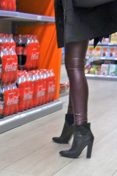 Rosina in the shopping mall - in red leather leggings and ankle boots