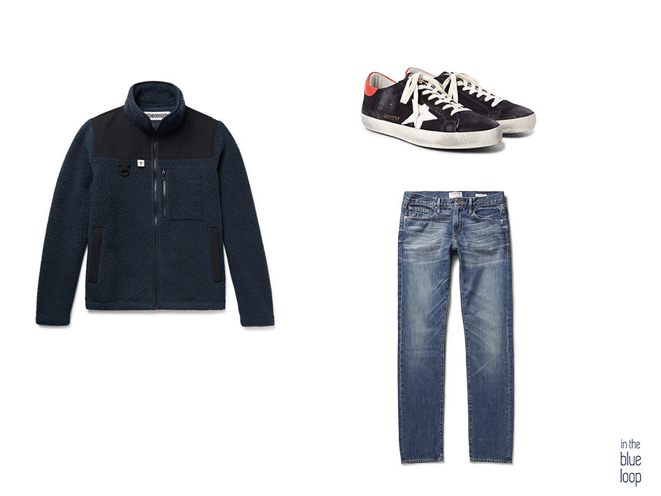 Look casual masculino con chaqueta de forro polar, sneakers y vaqueros