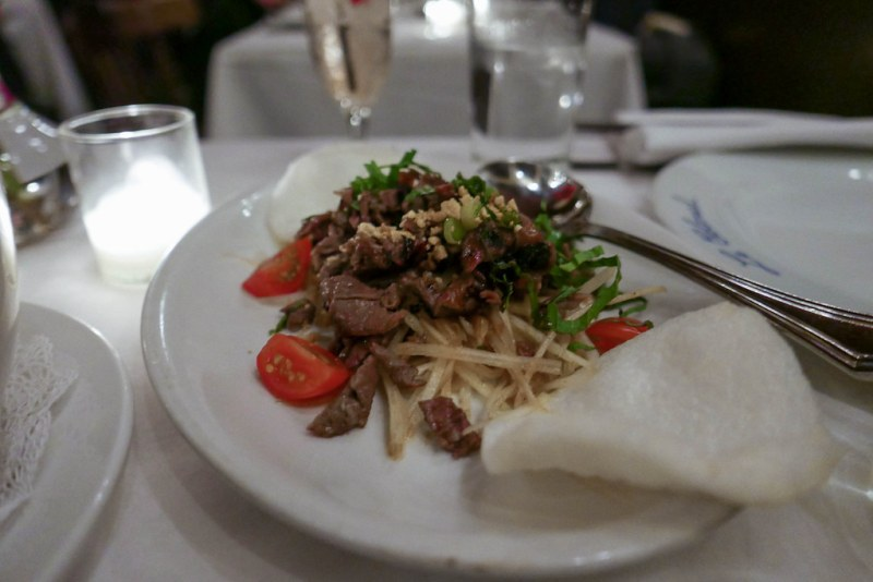 Bo Nuong, beef short rib, papaya, peanuts, basil, tamarind sauce ($12)