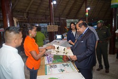 Prime Minister, Moses Nagamootoo and Acting President interacts with an exhibitor.
