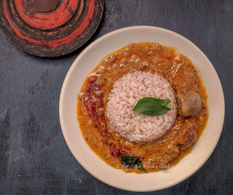 Image of Kerala Mutton curry served with boiled brown rice (matta/kuthari)