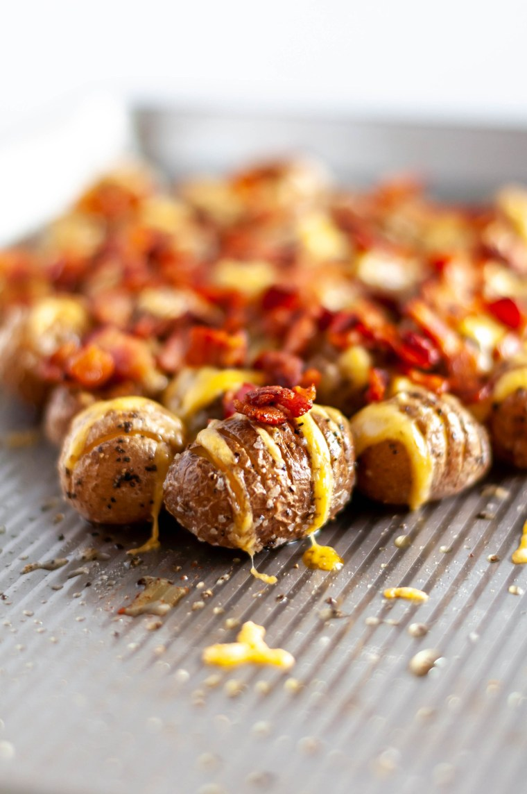 Loaded Mini Hasselback Potatoes are a delicious and adorable party appetizer your holiday needs. Serve with this simple, fresh dill sour cream.