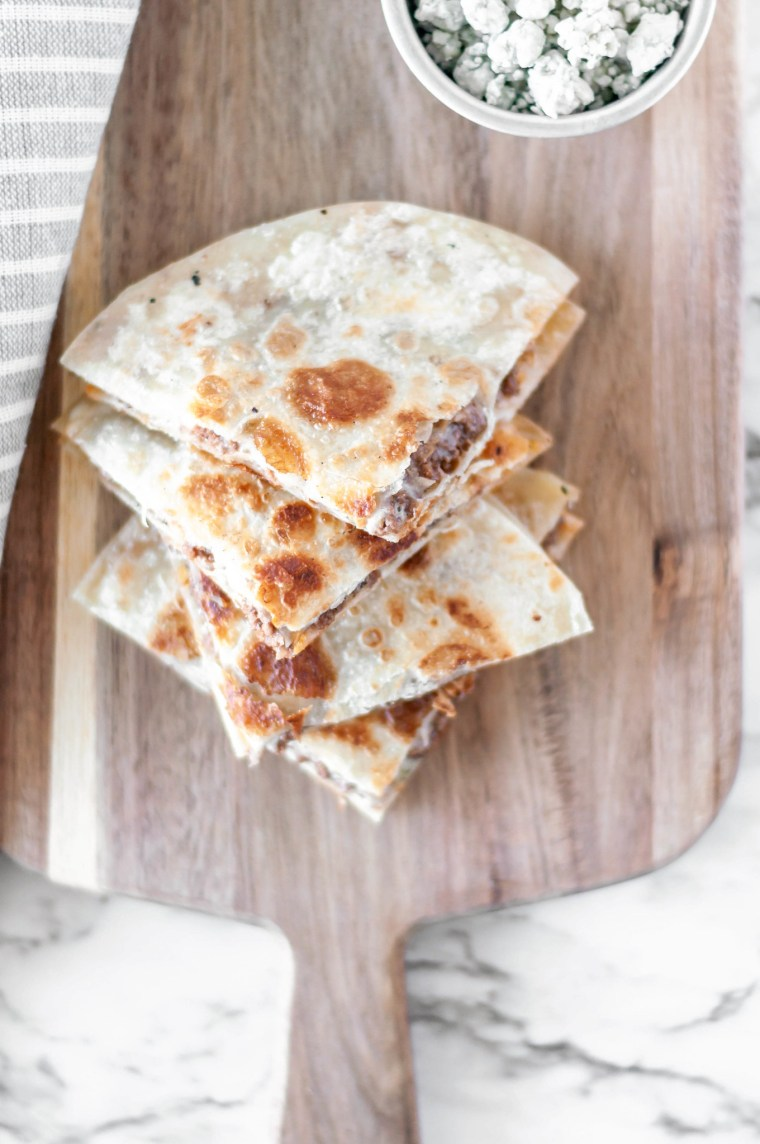 Black and Blue Quesadillas are packed with steak sauce drenched ground beef, blue cheese crumbles and stringy mozzarella. The perfect 30 minute meal for busy weeknights.