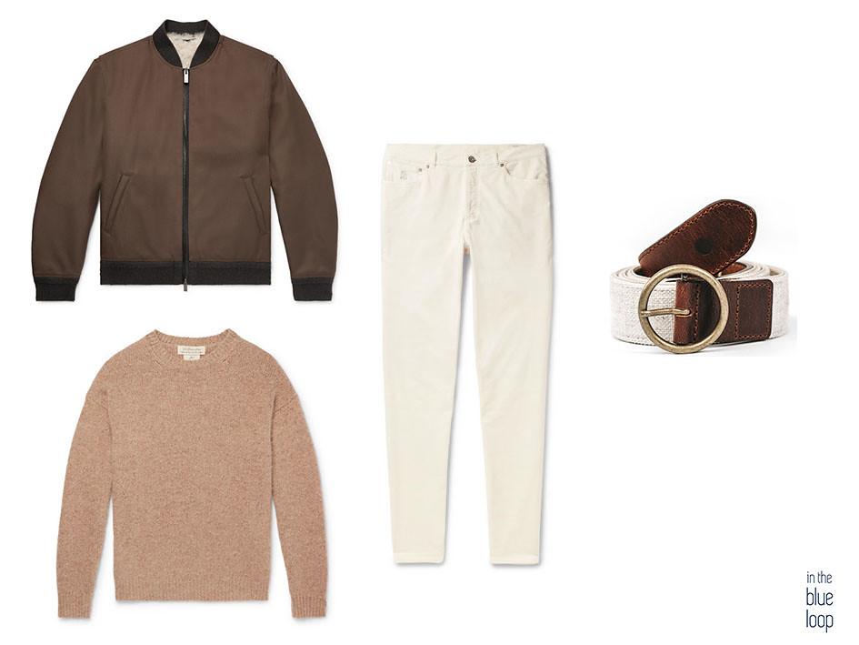 Look masculino con chaqueta de borrego o piel de oveja, cinturón Fataga de blue hole, jersey beige y vaqueros o jeans blancos