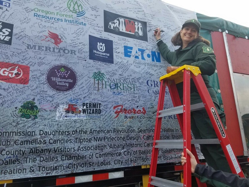 "Forest Service Public Affairs Officer signs ""The People's Tree"" as it passes through The Dalles. for"
