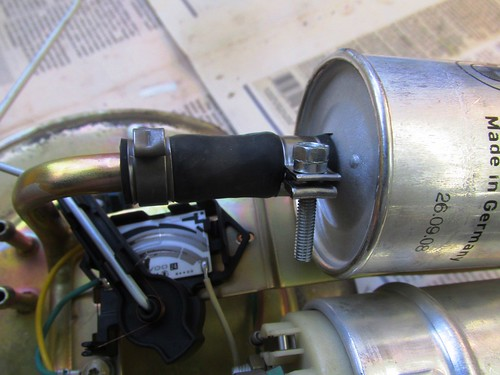 Fuel Filter with Original Use Once Clamp and Newer Reusable Clamp