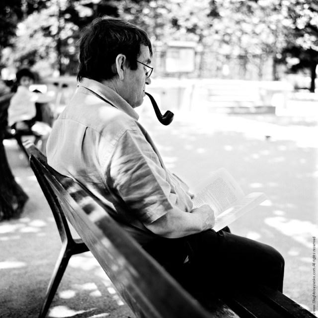 Reading the book, near the Notre Dame de Paris, France