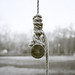 Round stick hanging from a rope