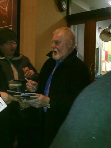 Derek Jacobi signing autographs