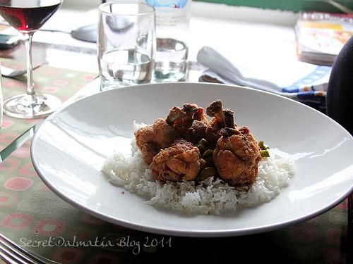 Fried chicken wings on basmati rice
