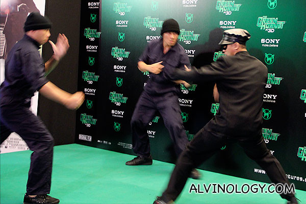 Some extras doing kungfu performances to stall for time