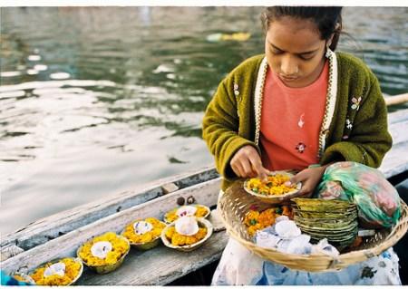 Preparing flower dishes to worship