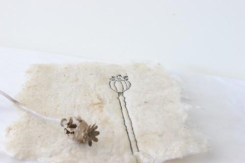 Poppy head embroidery