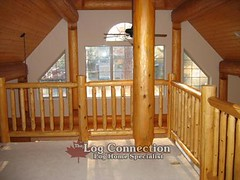 Log Guardrail in a Stacked Log Home