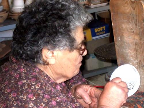 Italian woman hand painting ceramics