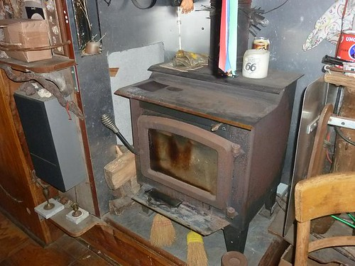 IL, Pontiac 83 -Bob Waldmire bus inside woodburning stove