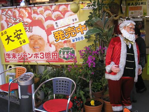 Santa outside the lottery ticket shop