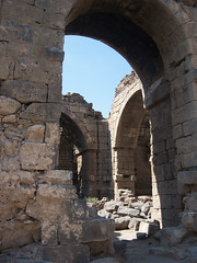 Roman ruins and arch at Bosra, Syria.