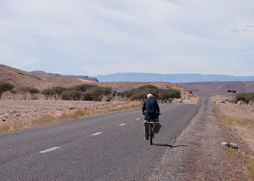 On his bicycle through the desert...