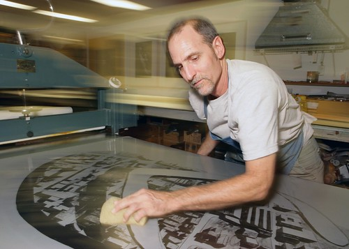 "Tom Pruitt works on ""Coco Solo"", a print created by Los Carpinteros and produced at Graphicstudio."