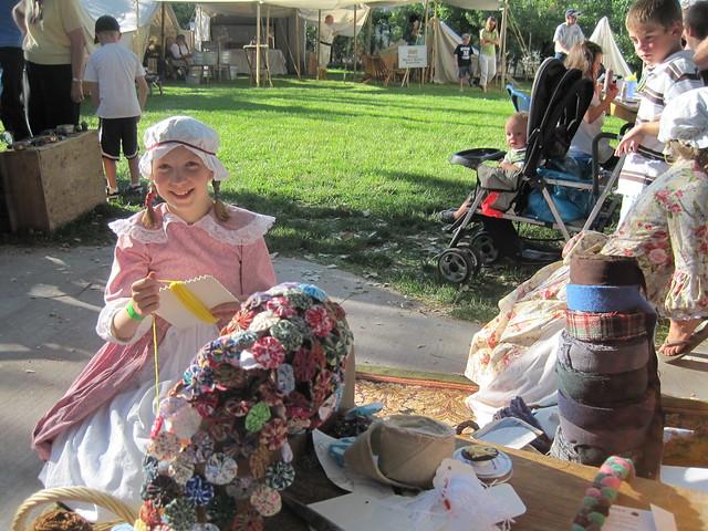 middle making yarn dolls