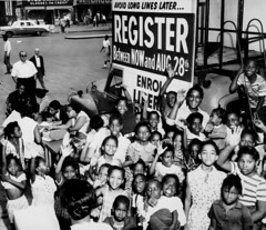 A large group of African American children gat...