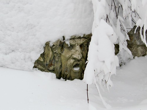 Stone face with snow