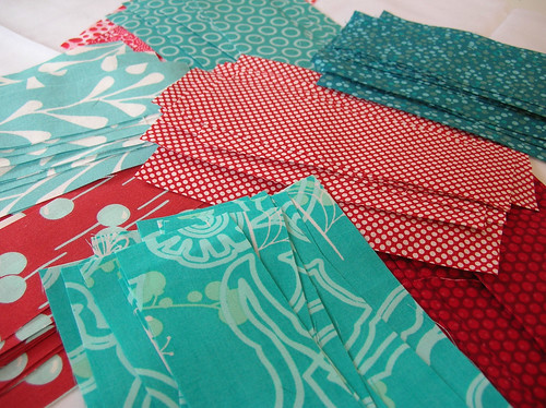 red and aqua fabric all cut up