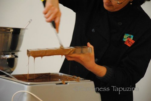 Scraping Off Excess Chocolate