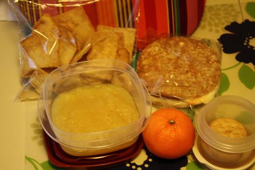 pita chips, applesauce, clementine, ham sandwich, peanut butter cookies