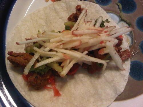 Spicy korean pork taco w apple-grapefruit slaw, pickled ginger and avocado