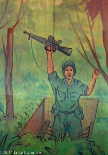 Cu Chi Tapestry of American Soldier falling into Trap