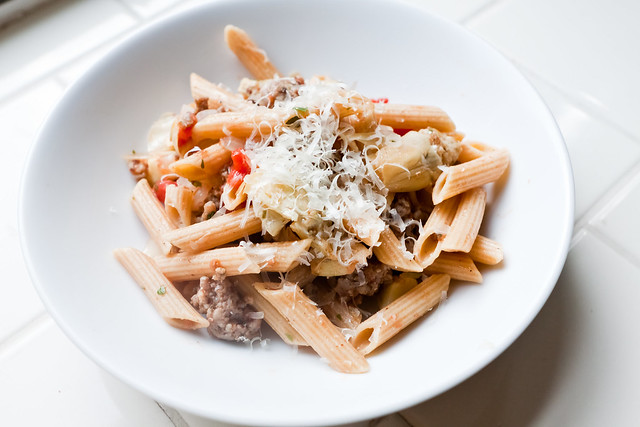 Penne with sausage, artichokes & tomatoes
