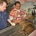 Examining raccoon, Animal Advocates, Mary Cummins